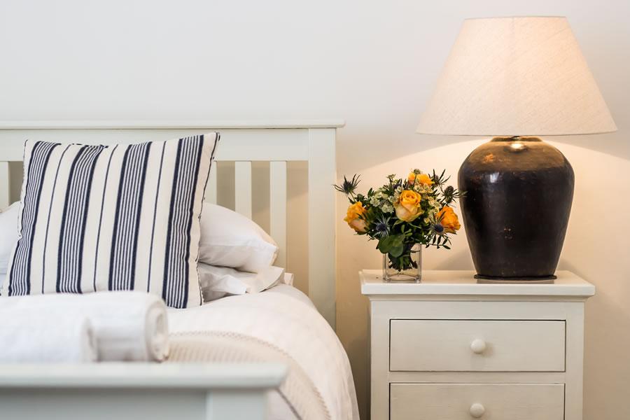 crisp white Egyptian bed linen & fluffy white towels | Blue Monkey Cornwall