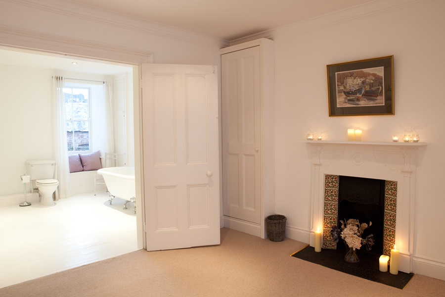 Fireplace in one of our bedrooms   Blue Monkey Cornwall