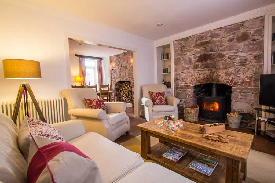 Luxurious living room with our cosy fire | Blue Monkey Cornwall