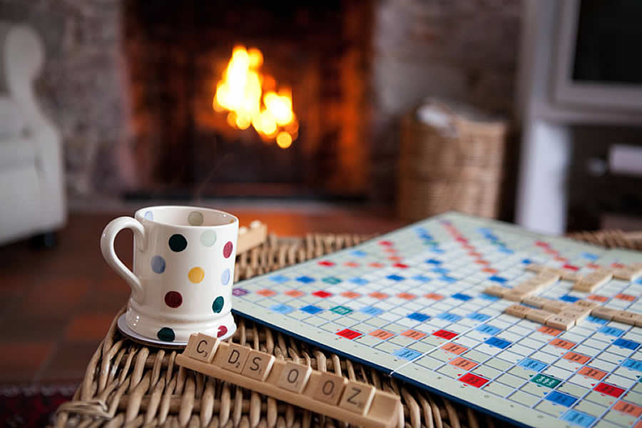 Relax with a nice cup of tea and game of scrabble at our family friendly cottage in Cornwall | Blue Monkey